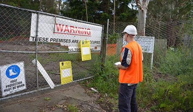 supervising arborist with warning signage